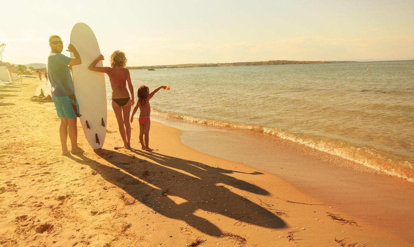 family on the beach - surfboard