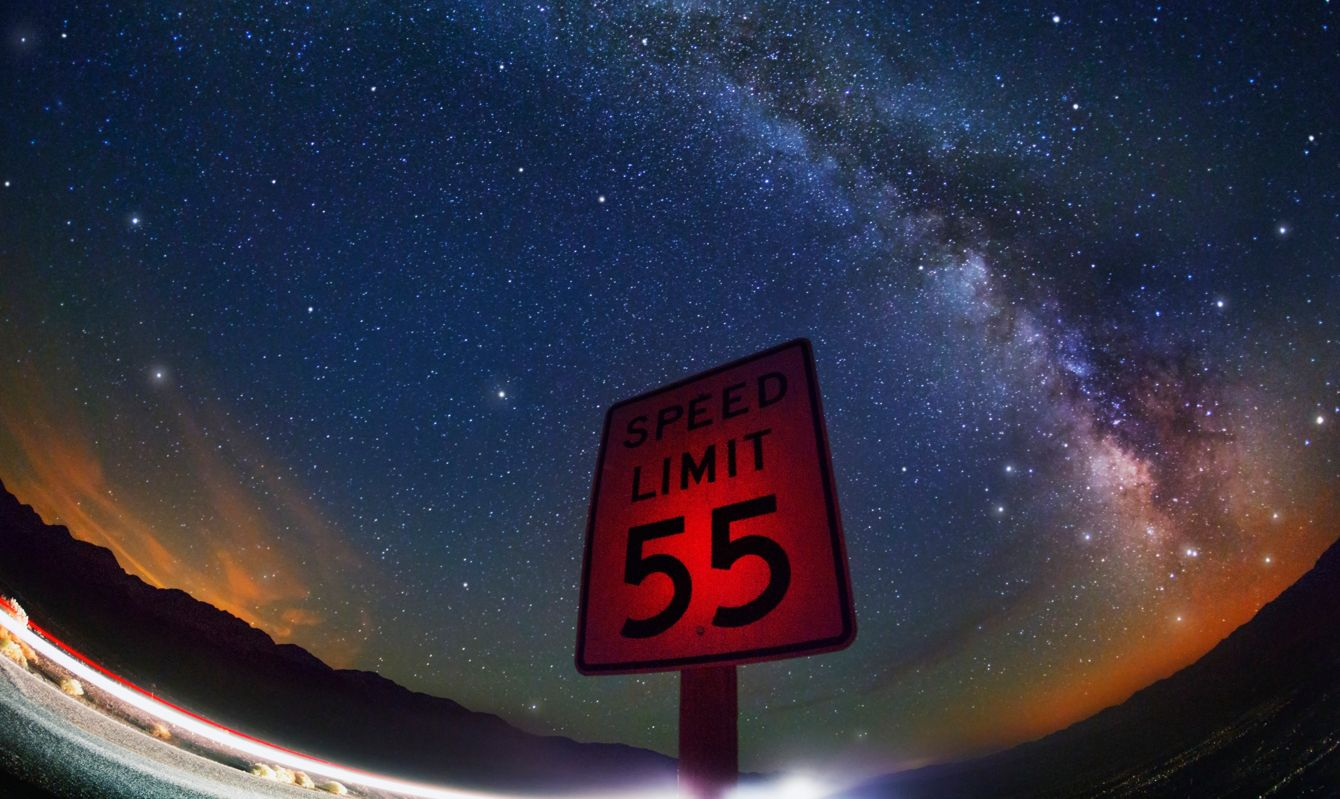 The Milky Way arching over a speed limit sign in Death Valley.