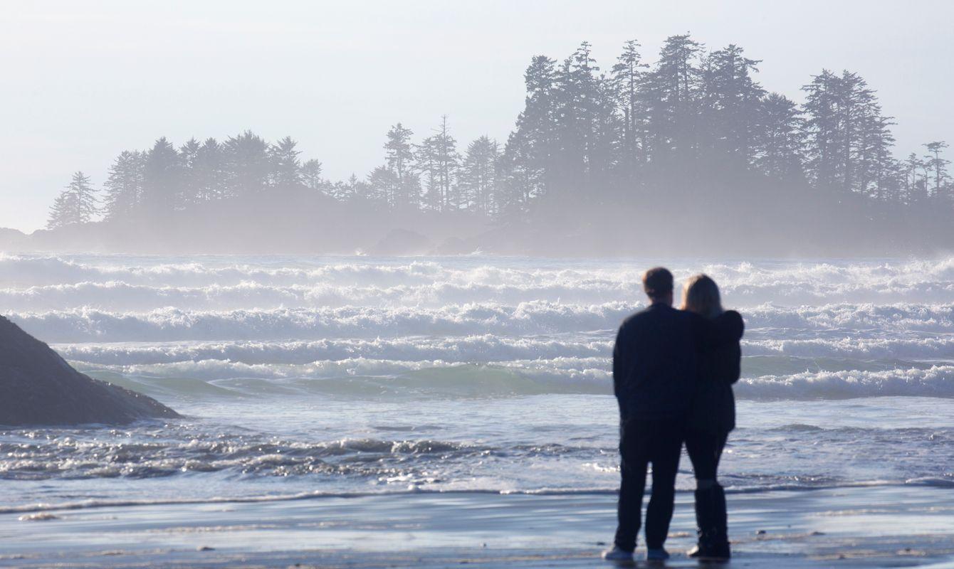 Young couple enjoying Long Beach waves.
