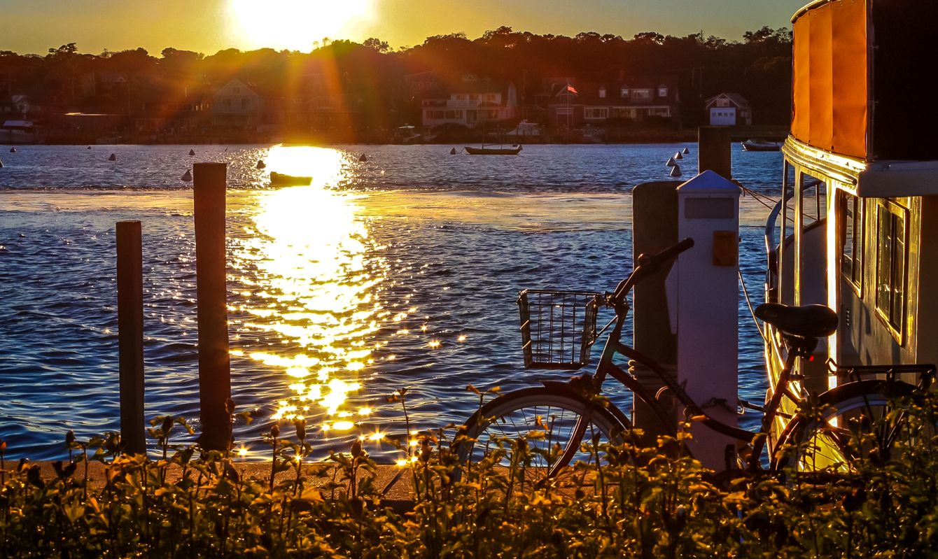 Bicycle in Harbor as sun sets over Martha's Vineyard, MA.