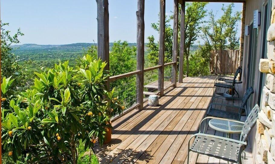 A wooden terrace with views of lush forests.