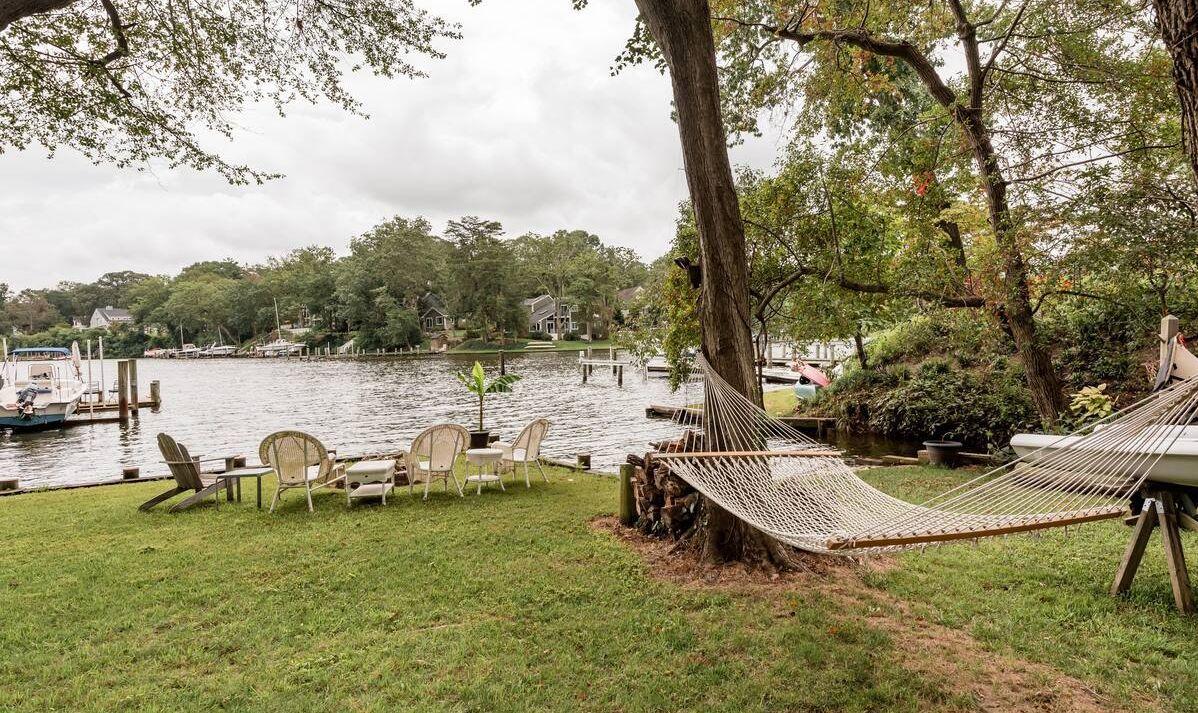 A hammock by a lake.