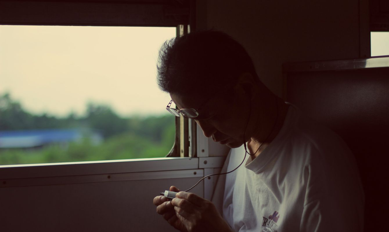 Man on a train looking at his smartphone