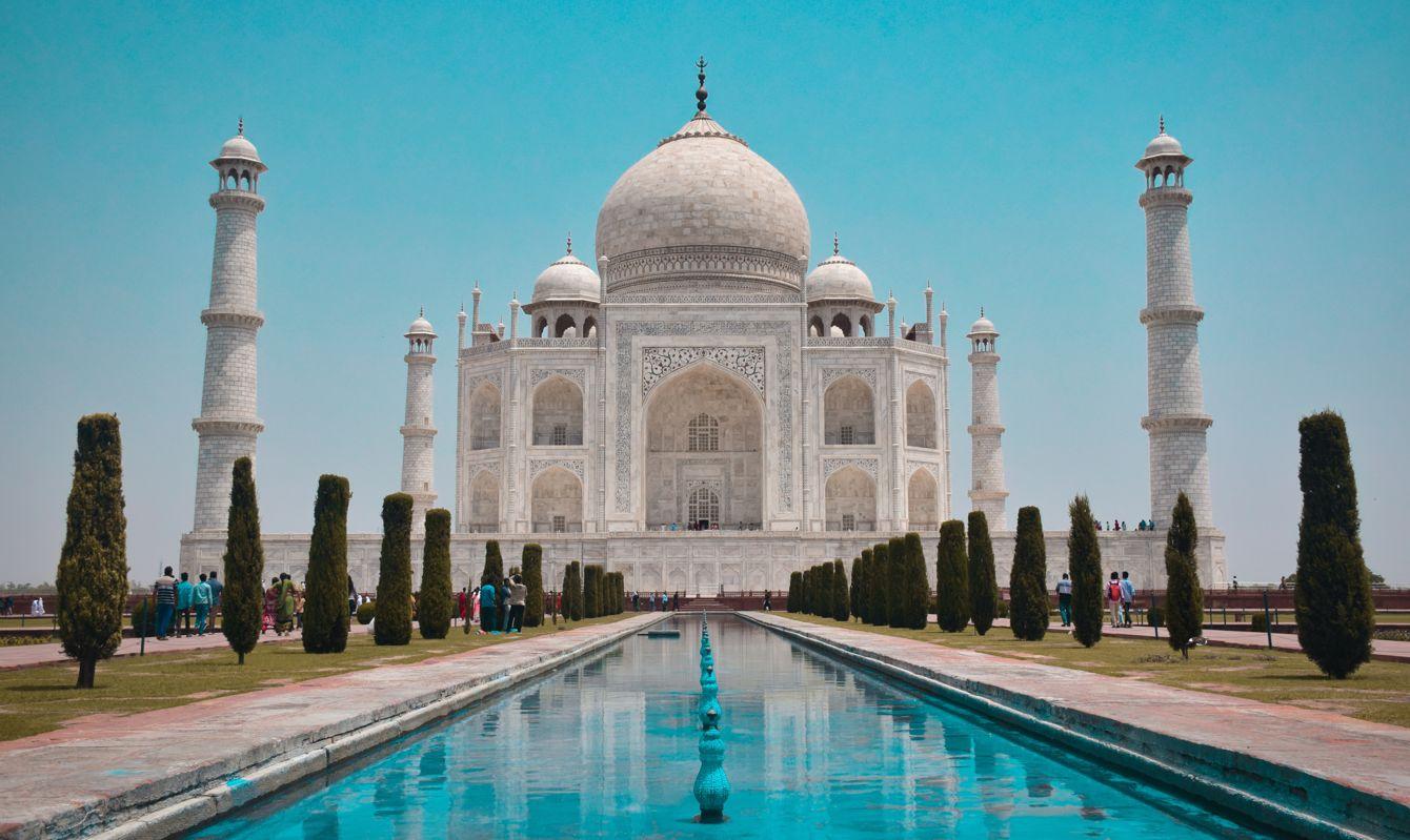 Iconic shot of the tree-lined avenue leading to the Taj Mahal.
