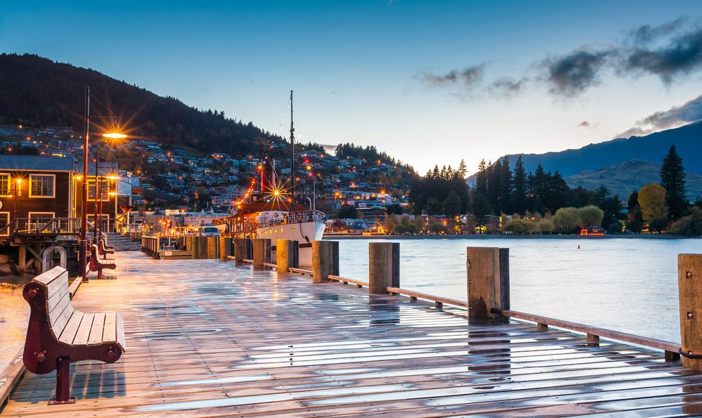 the waterfront at sunset in Queenstown, New Zealand
