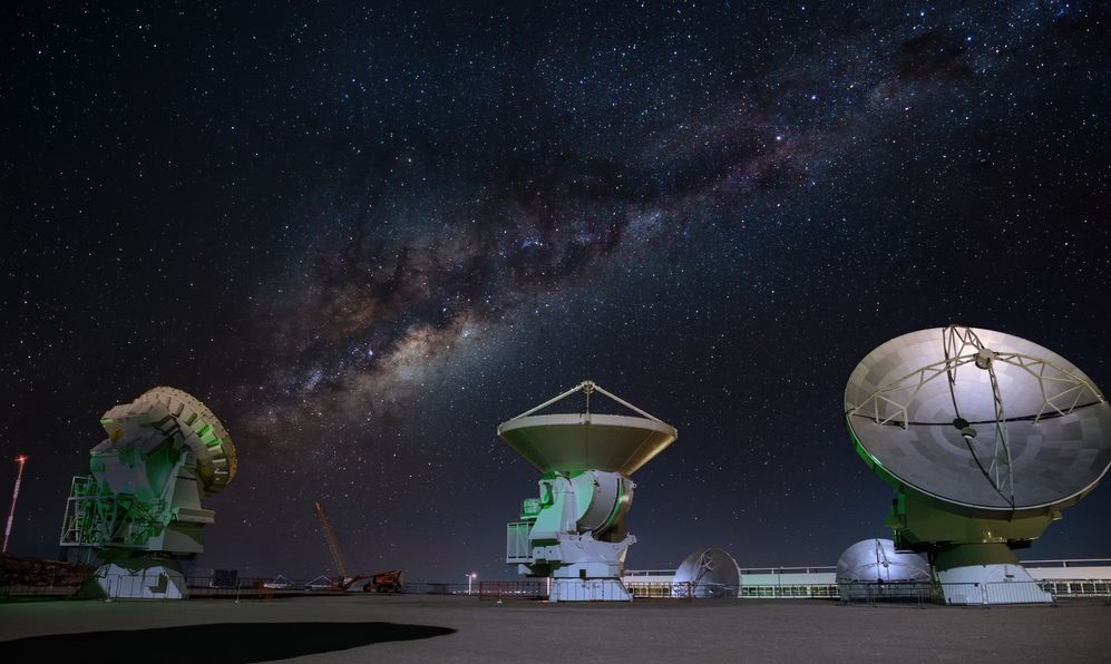 ALMA radio astronomy dishes watching the sky with milky way above