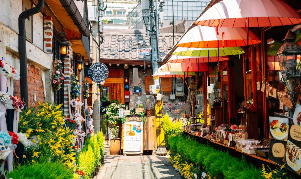 sidewalk in Seoul, South Korea with shops and flowers