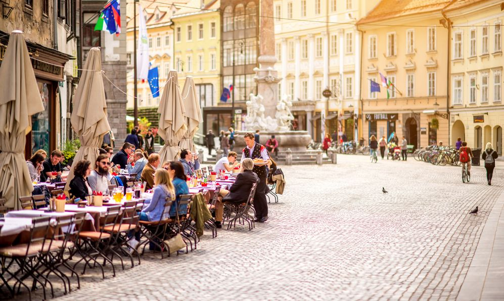 A cafe on a cobblestone street in Ljubljana, Slovenia