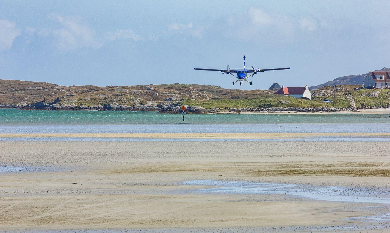 Airplane Landing on Beach Barra Scotland