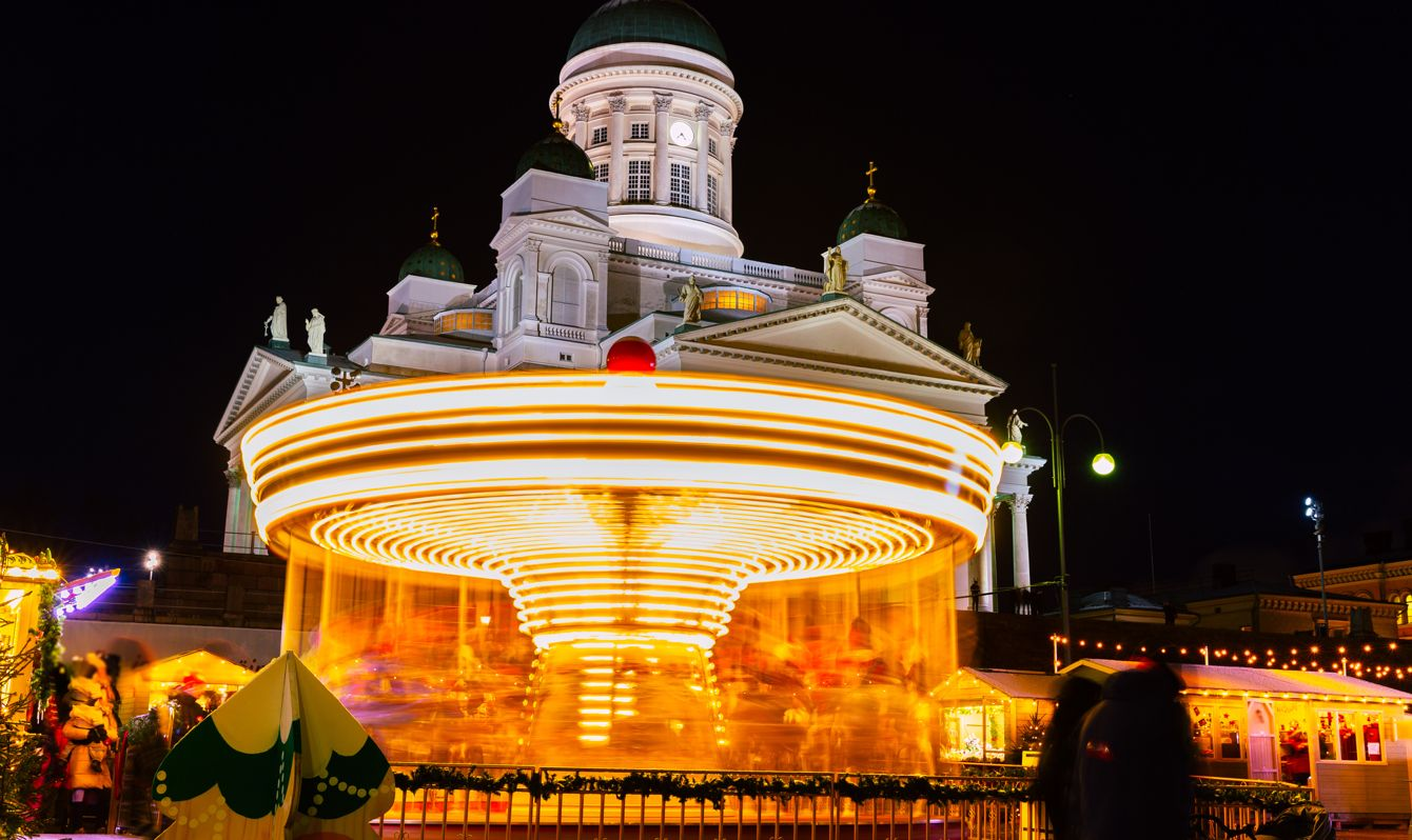 This pic shows The helsinki chrstmas market and illuminated Senat Square with the Helsinki cathedral in winter time. The square is decorated with Christmas lights and market. The pic is taken in december 2019.