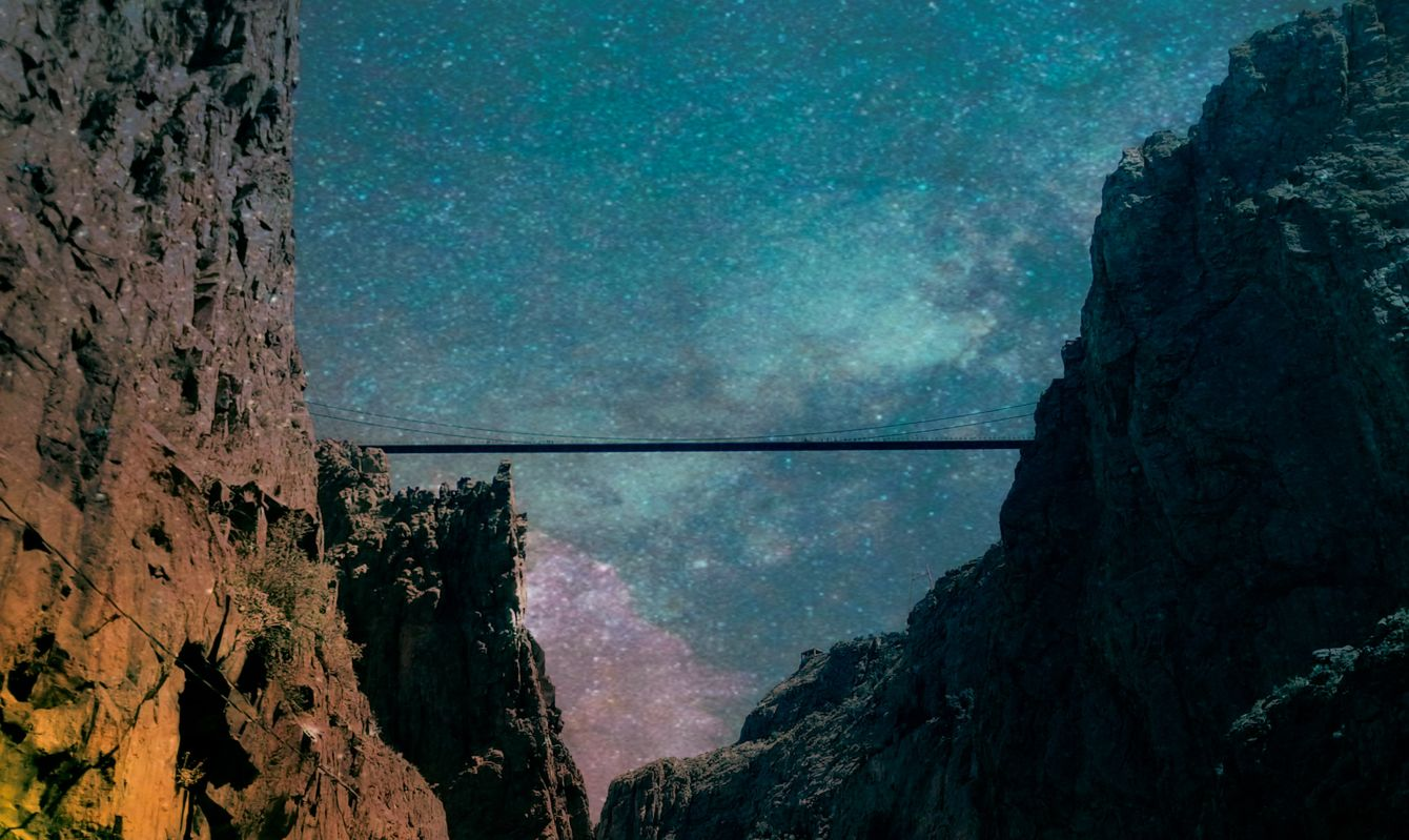 Nighttime view of the Royal Gorge Bridge in Colorado.