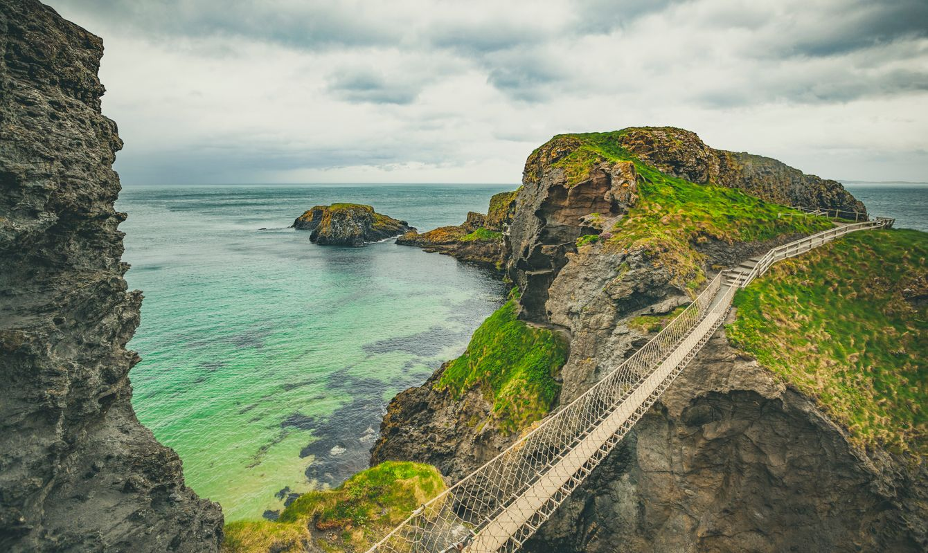 famous carrick a rede rope bridge on the coastline of northern ireland, europe.