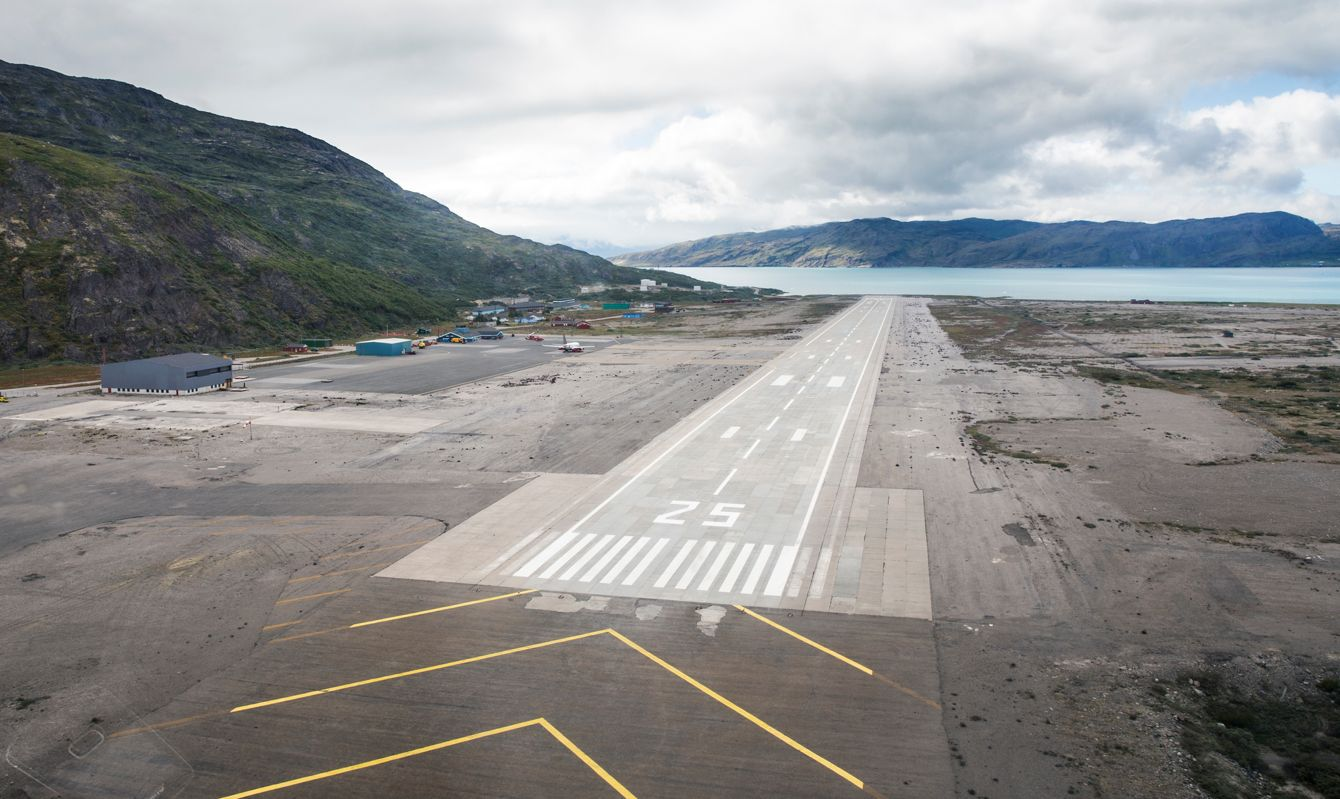 Narsarsuaq unusual airport runway location in Greenland. Airstrip is empty. Aerial view of the runway.