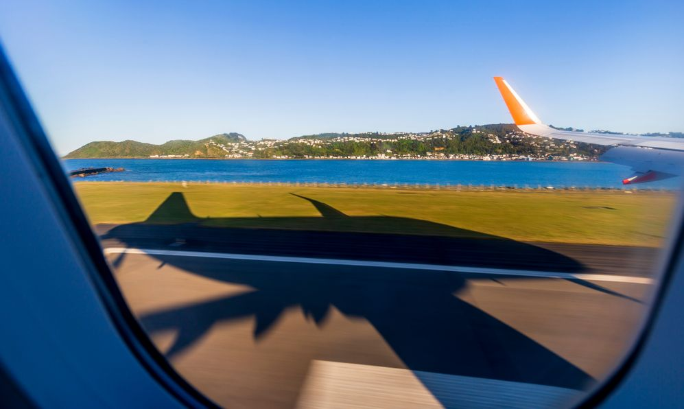 Big shadow of an aeroplane arriving at Wellington airport, New Zealand.