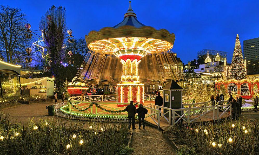 The carousel and christmas illumination in Tivoli Gardens, a famous amusement park and pleasure garden. Tivoli is the most-visited theme park in Scandinavia.