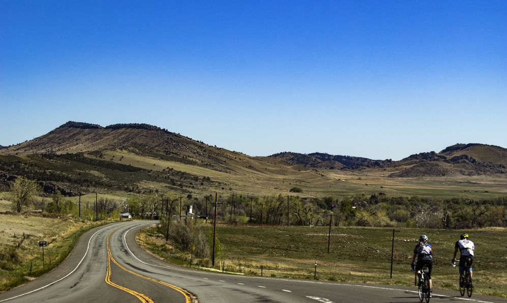 bikers on a road along the Rocky Mountains foothills near Boulder
