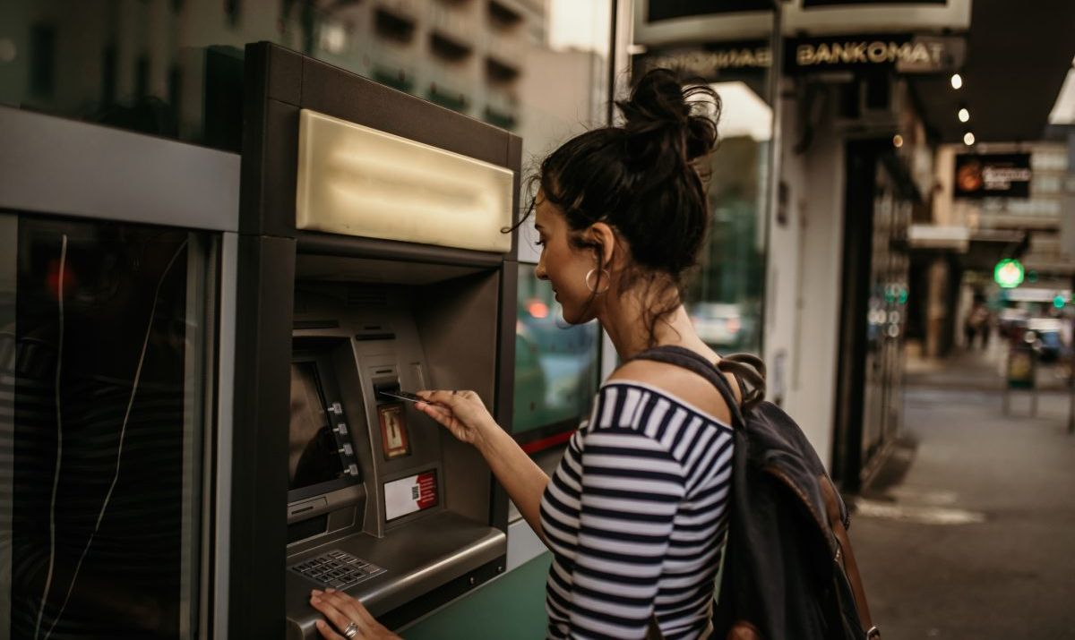 Woman using an ATM in the city.