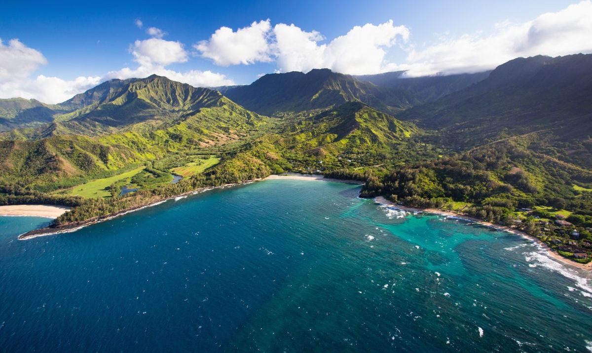 The reasons that draw people to Hawaii: mountains and ocean paradise.