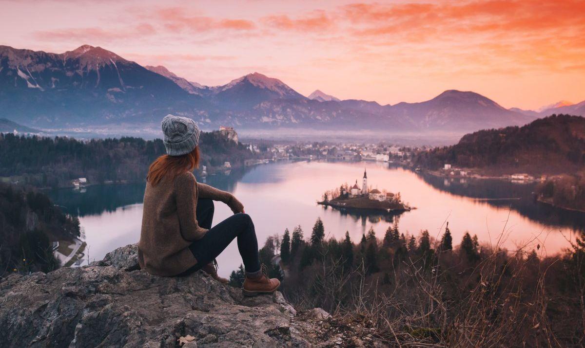 Female hiker overlooking lake in Slovenia
