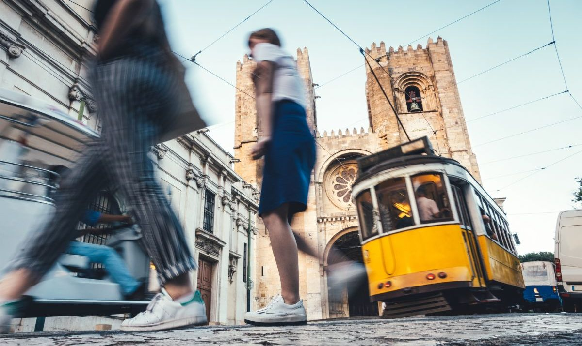 People walking by Lisbon Cathedral