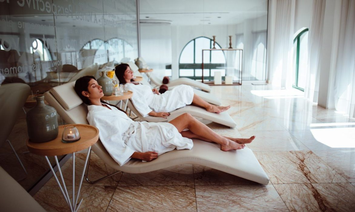 Women lounging in recliners at the spa.