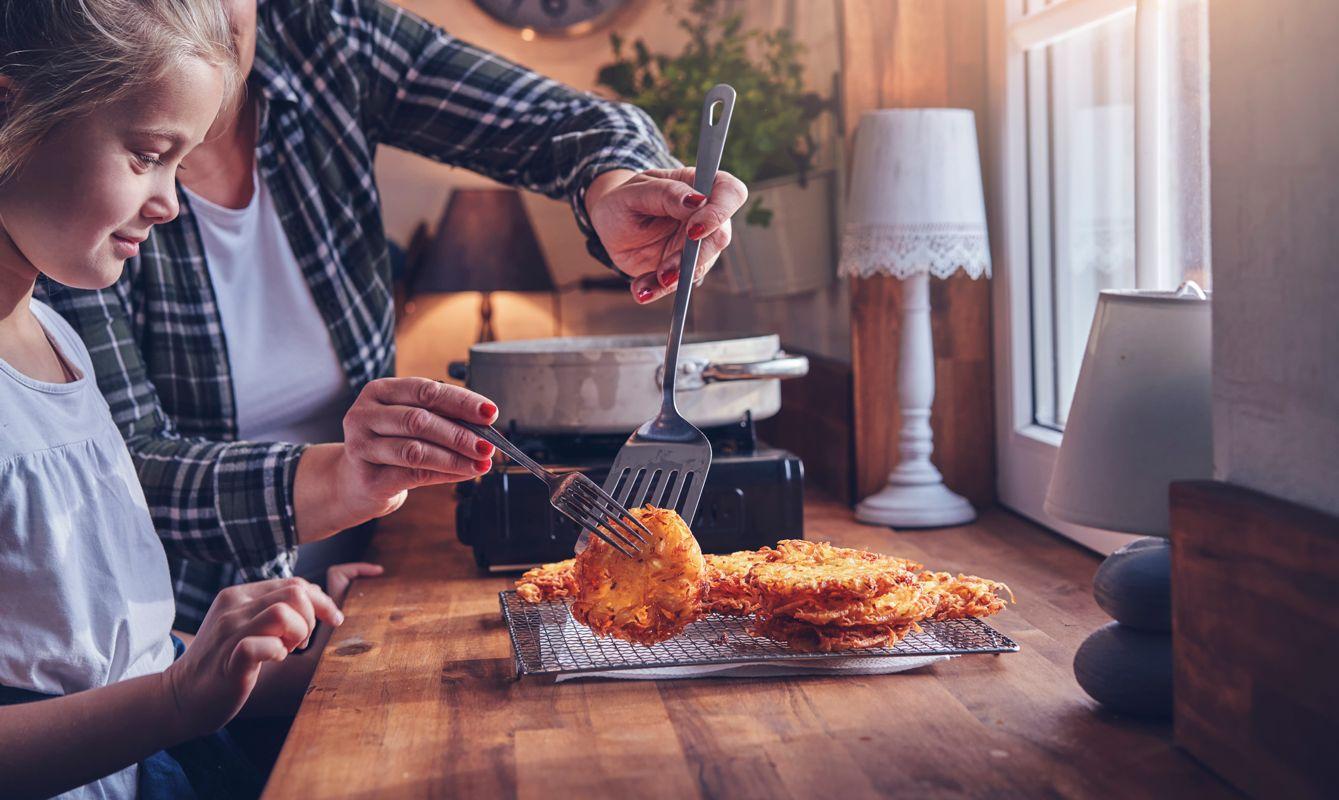 Preparing Rosti Potato Pancake in Domestic Kitchen