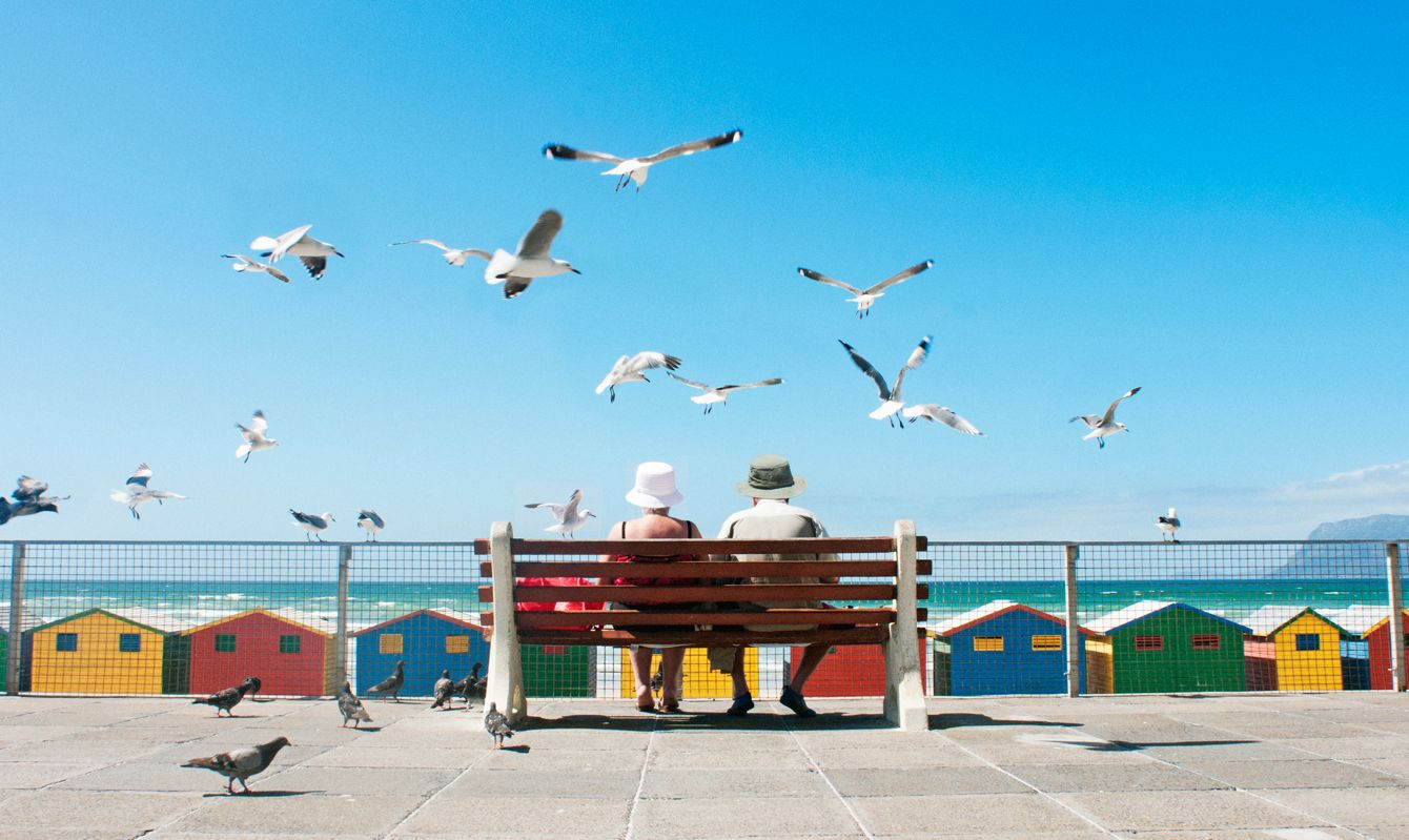 A senior couple enjoy lunch at Muizenberg Beach in Cape Town.