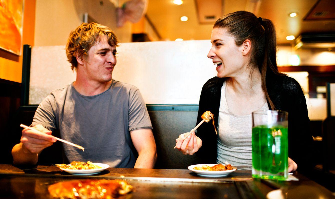 Young people eating in Japanese restaurant, Tokyo. Image is taken during Tokyo istockalypse 2015.