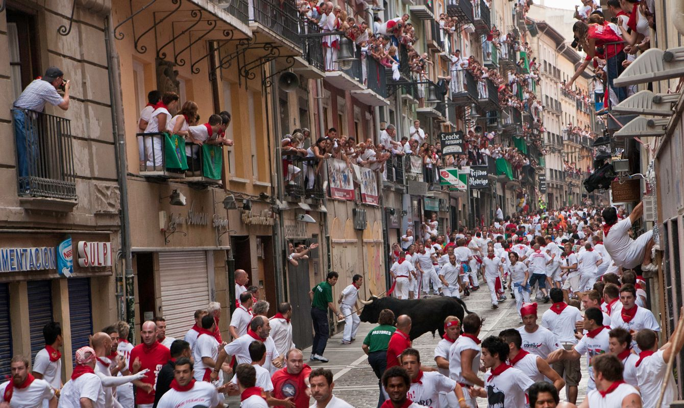 The Festival of San Fermin (or Sanfermines) in the city of Pamplona where the Running of the Bulls involves thousands of participants, Navarre, Spain.