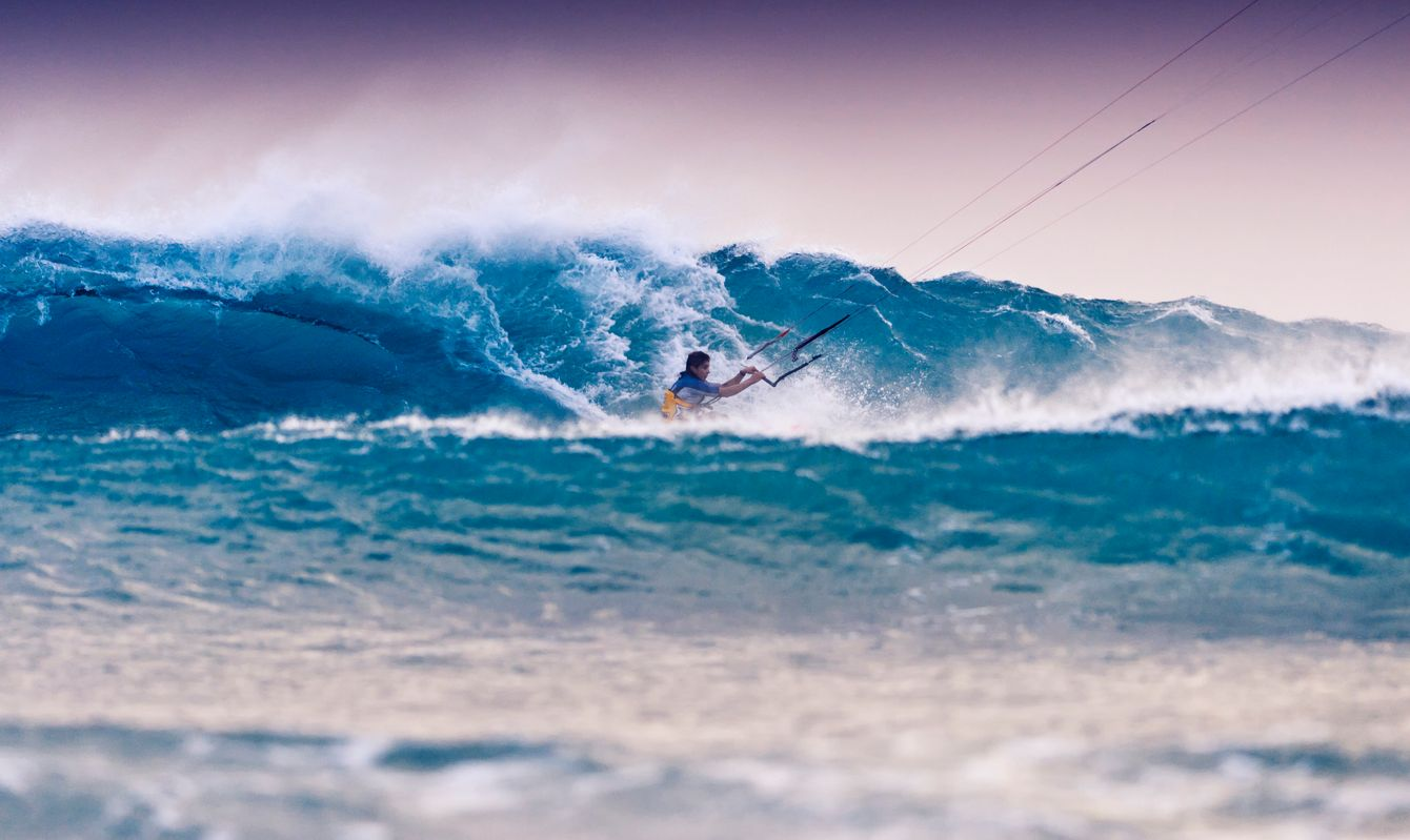 Kitesurfer surfing wave