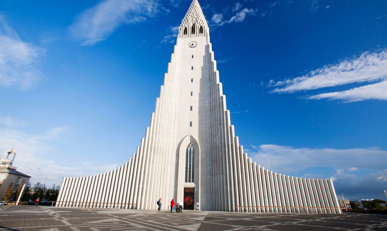 The iconic Hallgrims Kirkja in Reykjavik, Icelands largest church, designed by Gudjon Samuelsson, to resemble columnar jointing in Basalt lava flows.