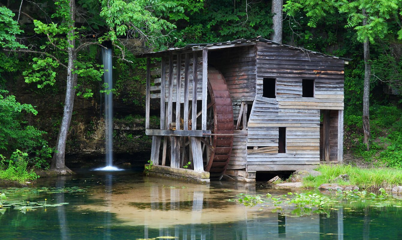 Falling Spring Mill near Winona, MO, deep in the Ozarks. It once generated electricity and ground corn, being powered by Falling Spring, which flows naturally out of the rock wall like a waterfall.