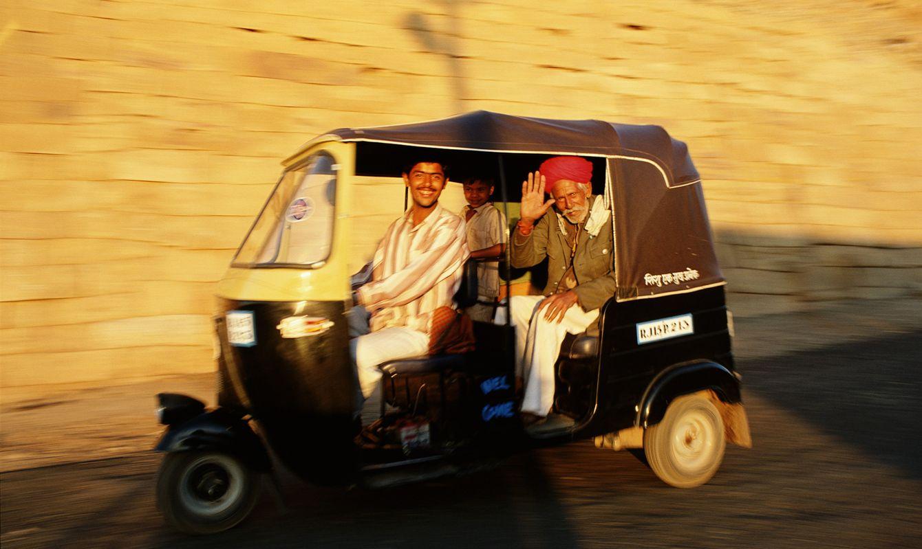 Passengers traveling in auto rickshaw