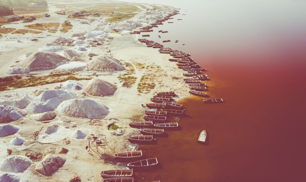 Aerial view of the pink Lake Retba or Lac Rose in Senegal. Photo made by drone from above. Africa Natural Landscape.