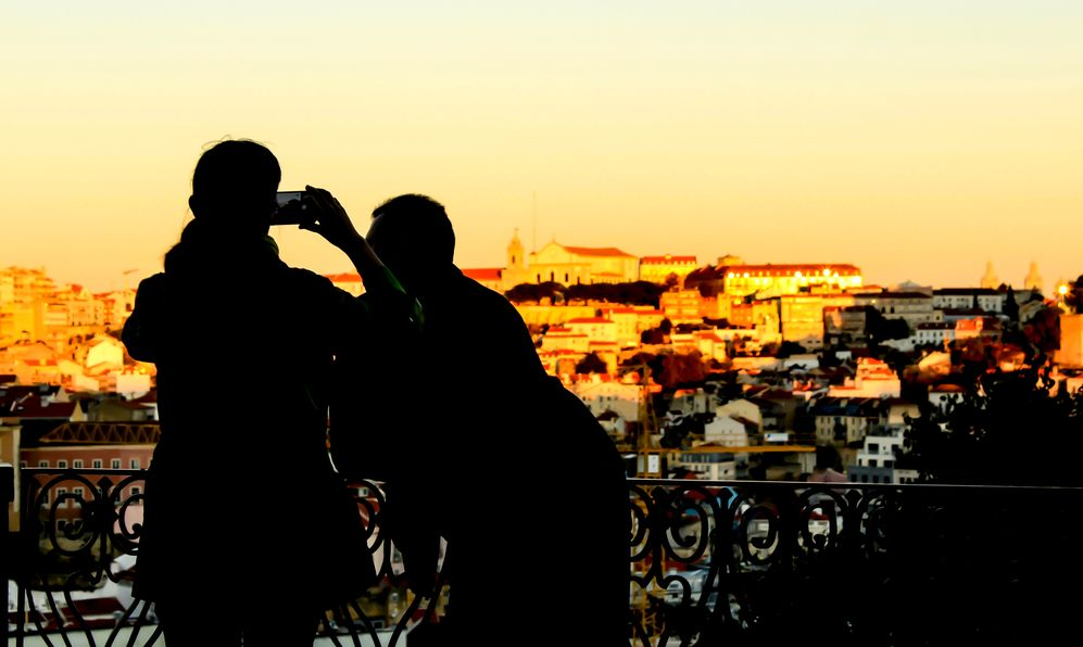 People watching the sunset in a viewpoint of Lisbon in Autumn