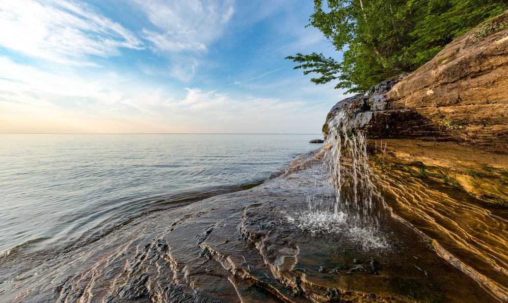 Elliot Falls spills over sculpted rock at Pictured Rocks National Lakeshore in Munising Michigan