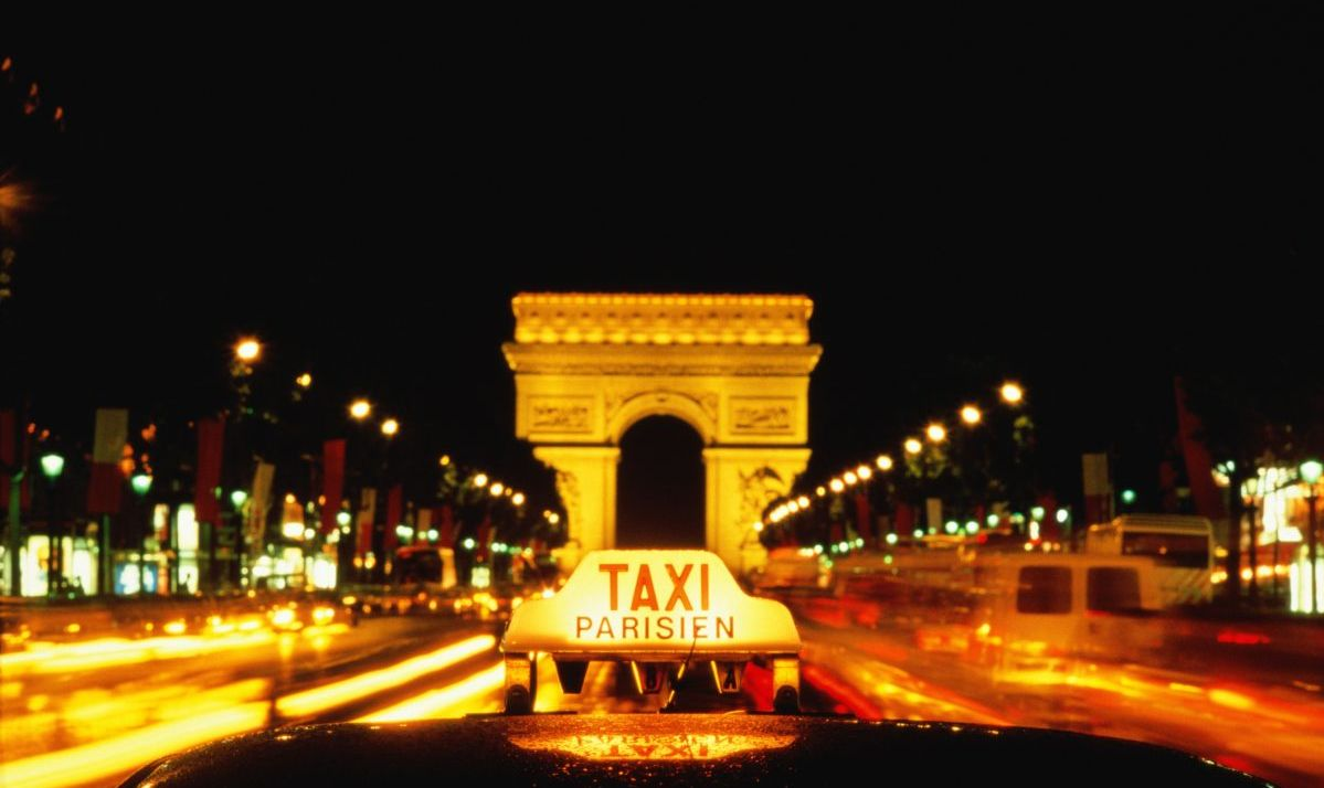 https://www.gettyimages.com/detail/photo/france-paris-arc-de-triomphe-taxi-sign-in-royalty-free-image/549914-001?adppopup=true
