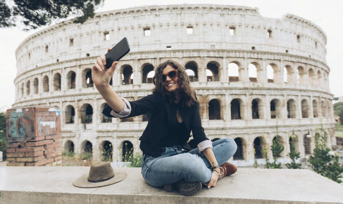 https://www.gettyimages.ca/detail/photo/young-woman-taking-selfie-in-front-of-coliseum-royalty-free-image/907649062?adppopup=true