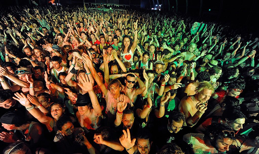 BUDAPEST, HUNGARY - AUGUST 13: Festival-goers cheer at Day 3 of The Sziget Festival on August 13, 2010 in Budapest, Hungary.