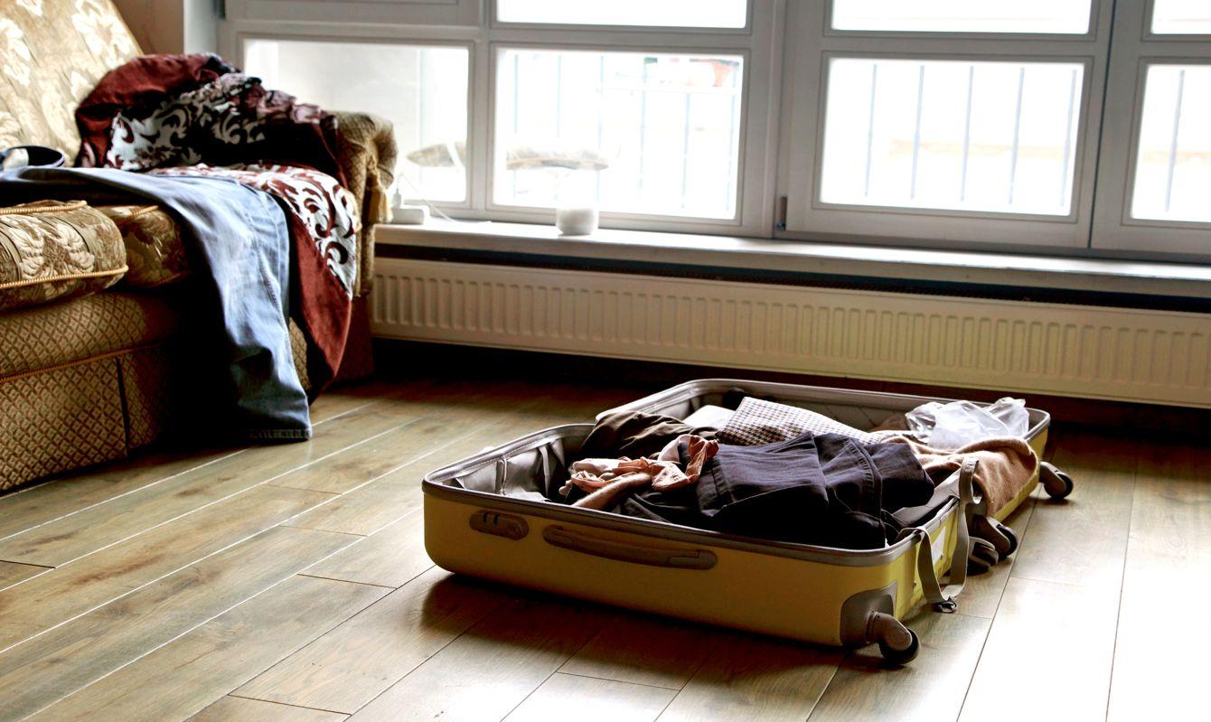 Open suitcase on floor.