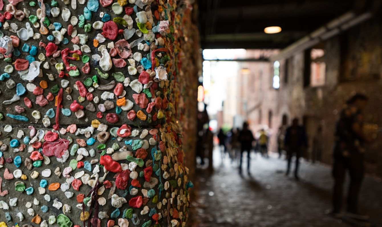 The Seattle Gum wall with unrecognizable people.