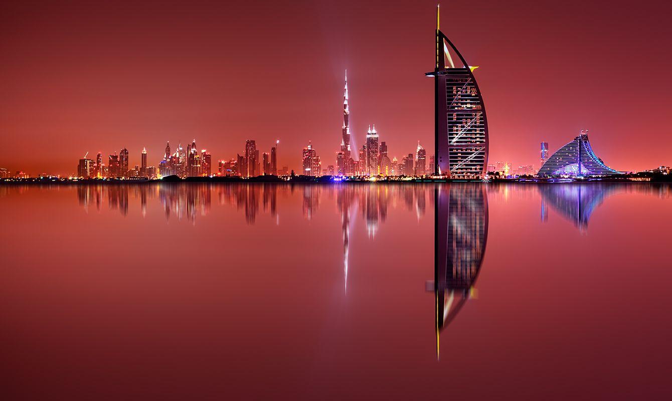 Dubai skyline reflection at amazing night, Dubai, United Arab Emirates