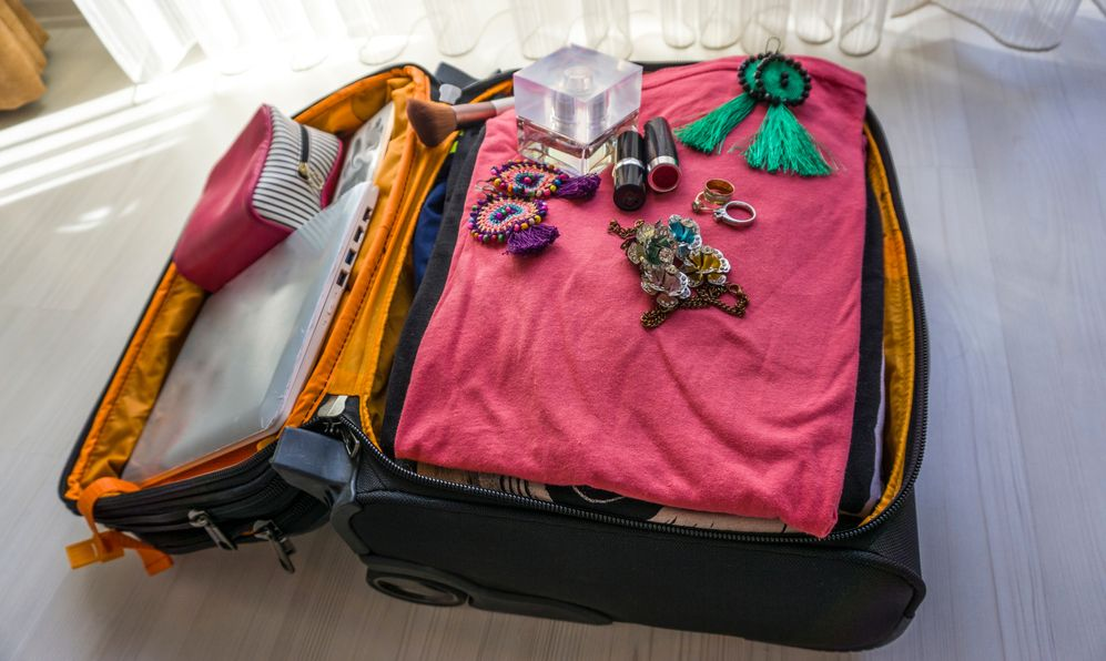 Closeup of woman baggage on floor for holiday.