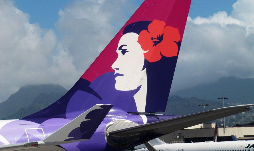 Tail of Hawaiian Airlines Airbus 330 plane at Honolulu International Airport, Oahu Island, Hawaii, USA